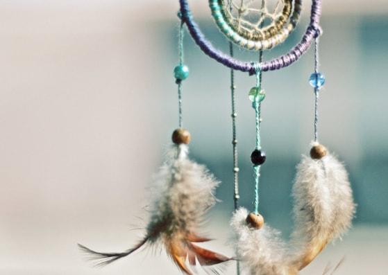 teal dream catcher with feathers