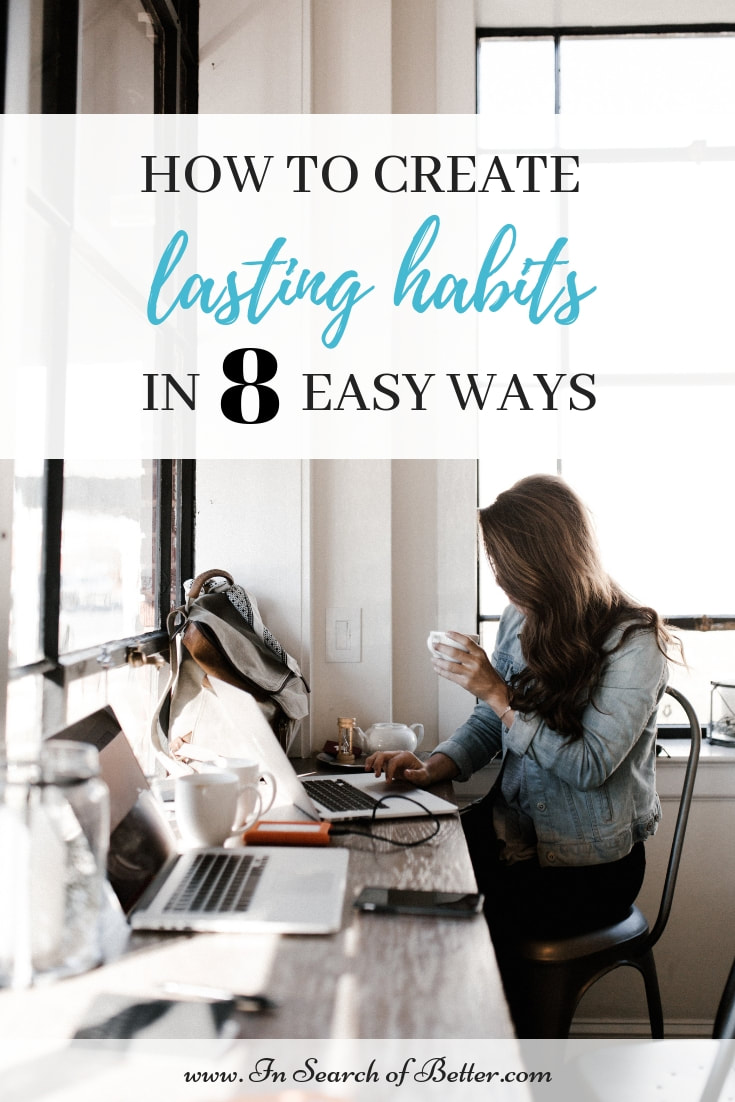 brunette working on laptop in coffee shop with text overlay - how to create lasting habits in 8 easy ways