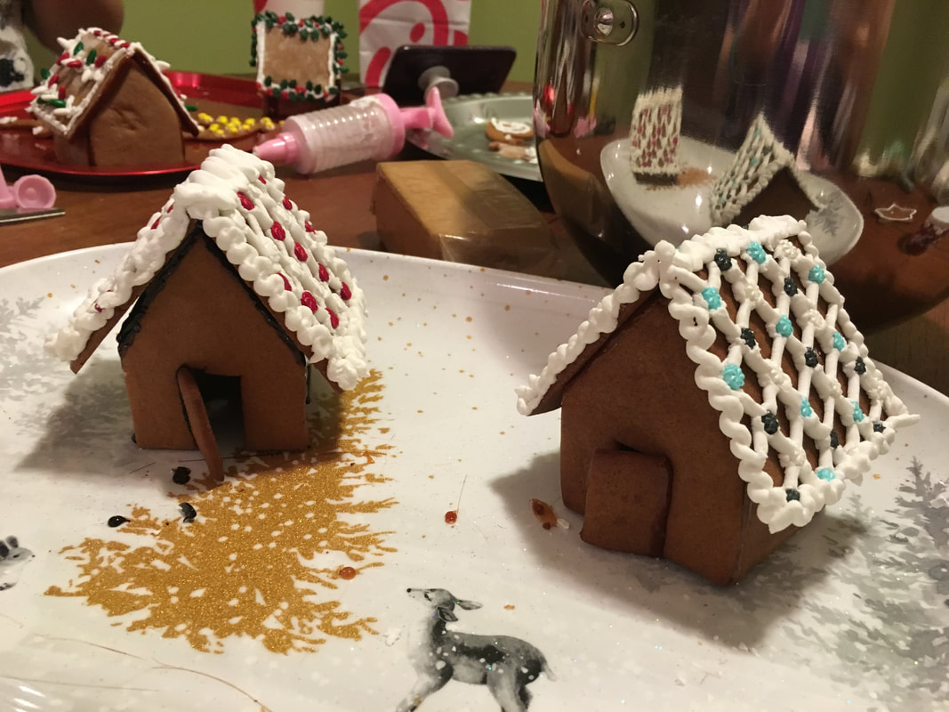 My homemade gingerbread houses on messy table
