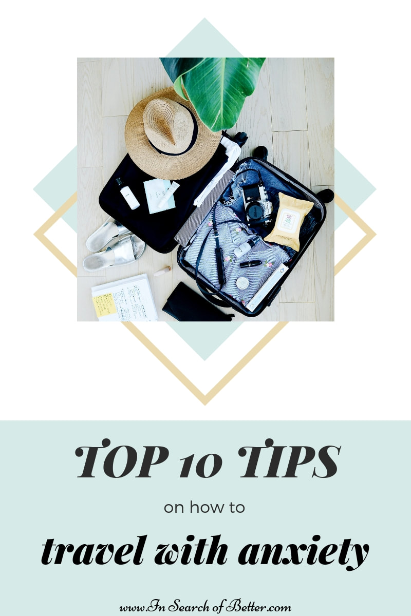 open black suitcase overslowing with hat, clothes, camera, and shoes with text overlay -- top 10 tips on how to travel with anxiety